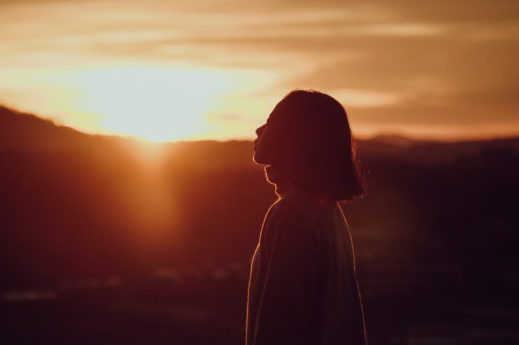 silhouette-photography-of-woman-at-golden-hour-1539759